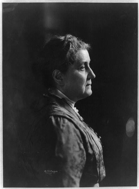 Jane Addams in profile, facing right.