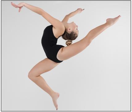 photo of gymnast poised on one toe