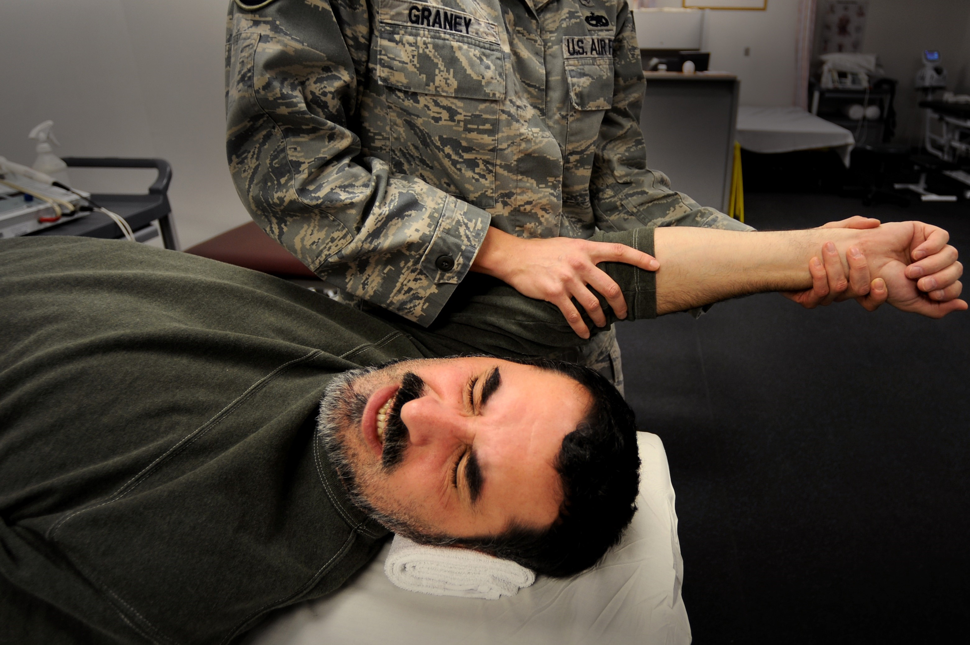 photo of a man receiving therapy for a torn rotator cuff
