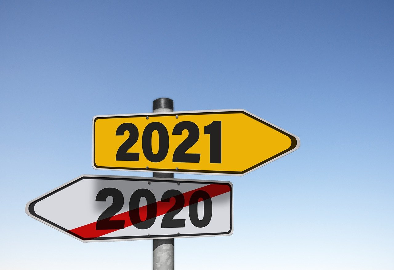 direction signs with 2021 and crossed-out 2020