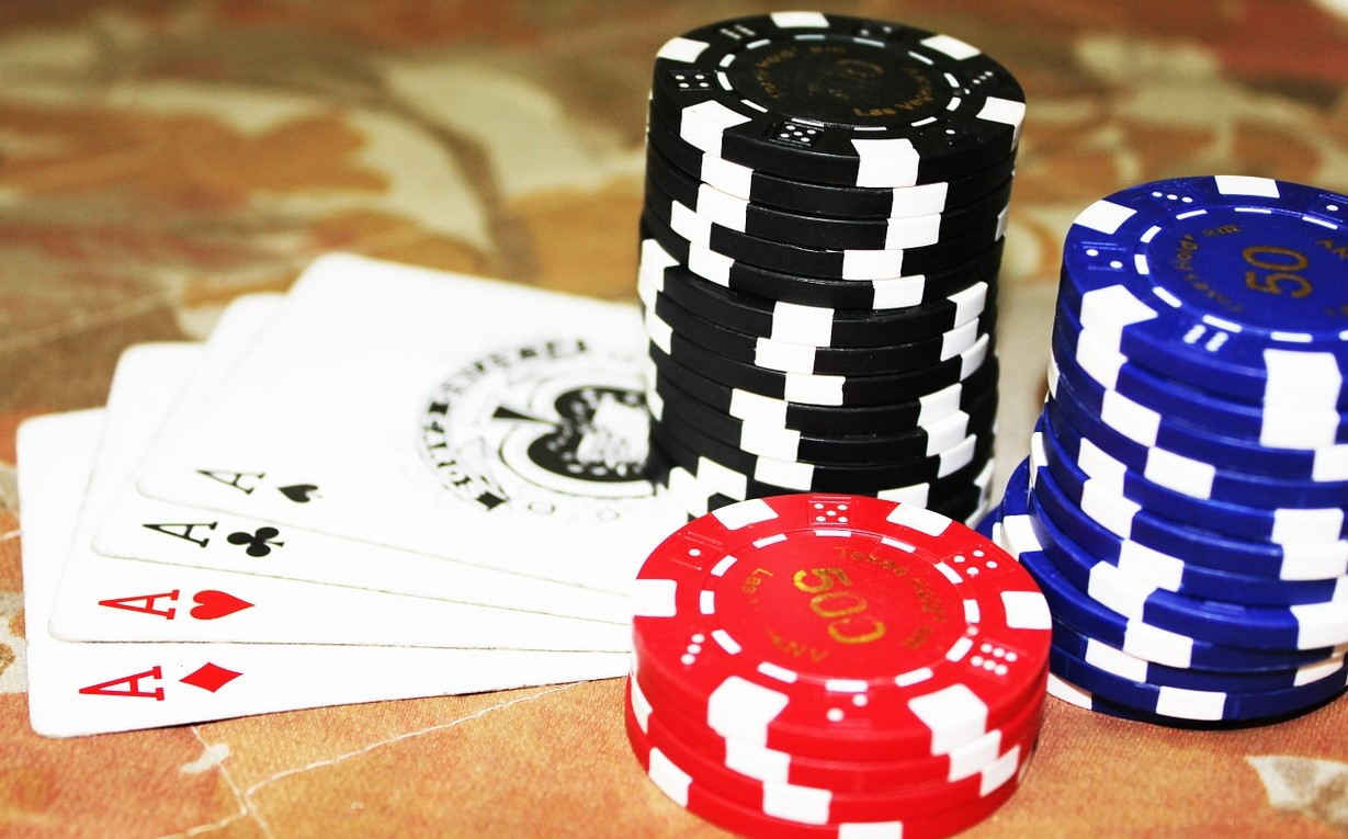 photo of poker chips and playing cards