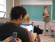 students texting while listering to a lecture