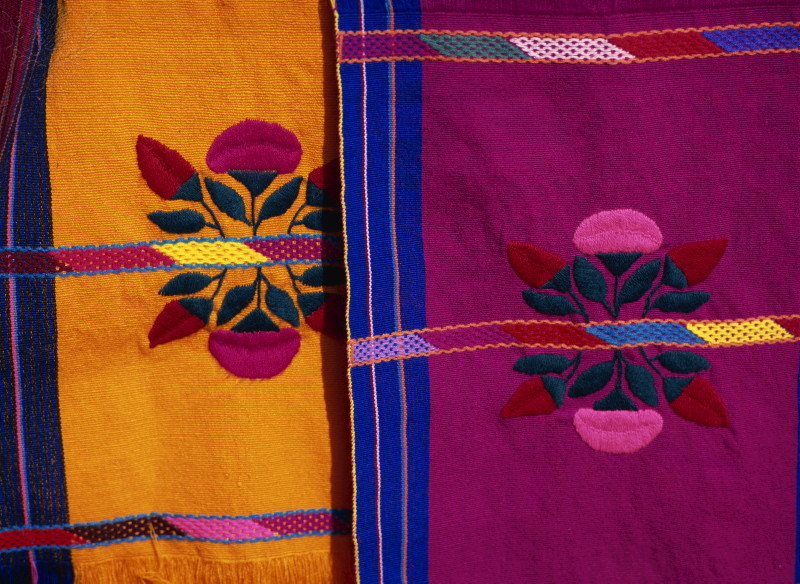 Two brightly colored craft rugs, Chiapas,Mexico