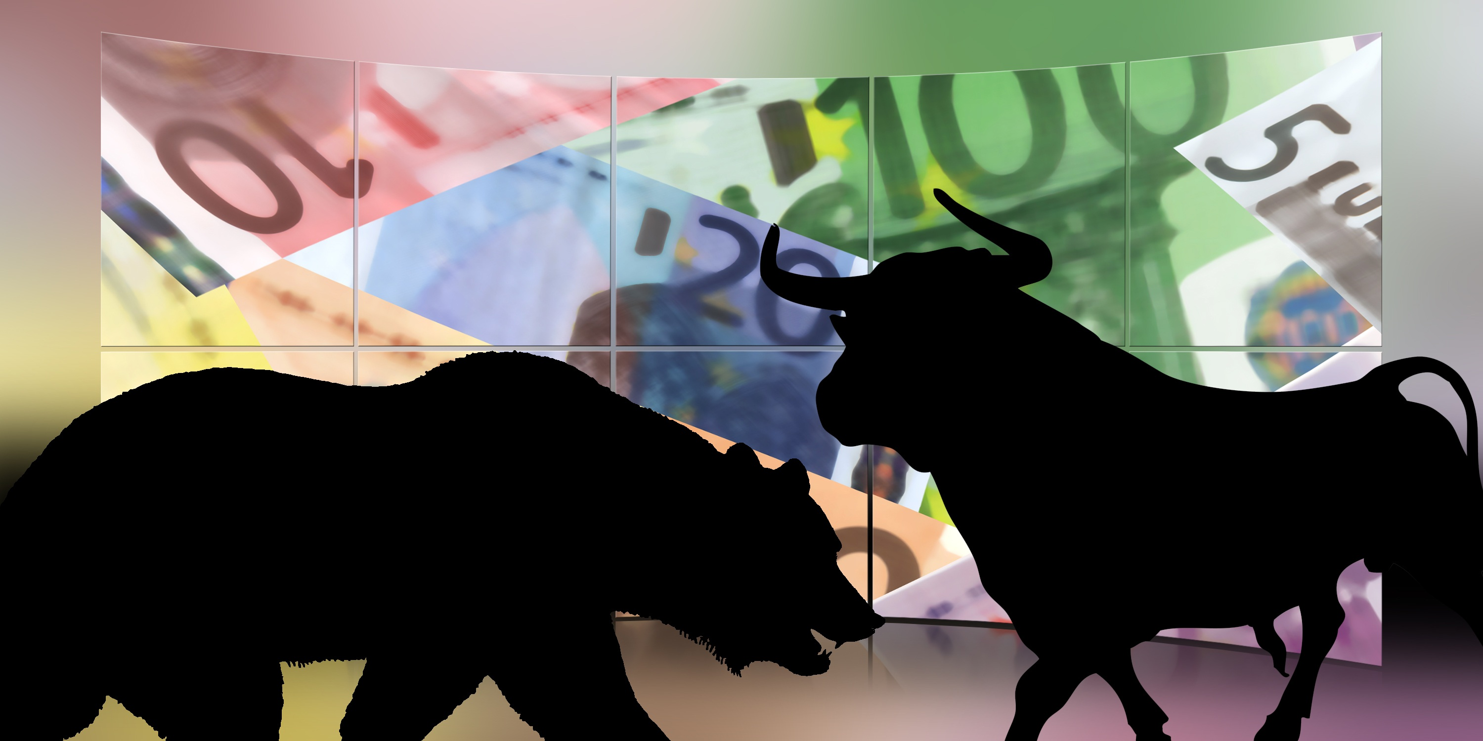 Bull and bear silhouette over forgien currency.