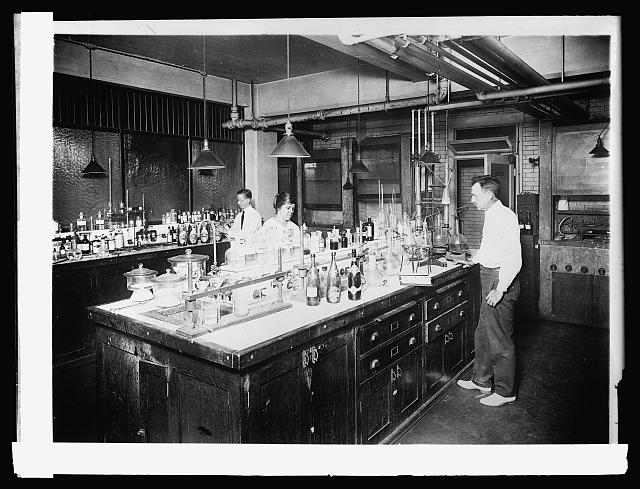 Three people in a chemistry lab for the U.S. Agricultural Department in 1920.