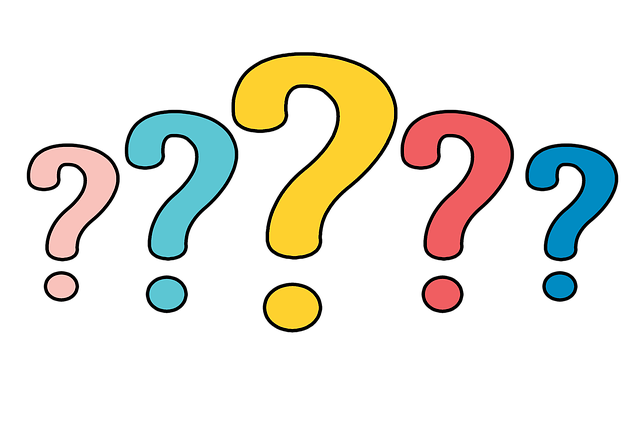 Five question marks in various colors