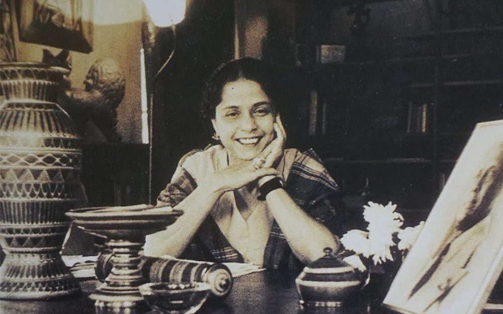 Photograph of Minnette de Silva sitting at a desk