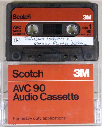 """photo of audiocassette and case. Handwritten on the cassette, """"4/23 Scholar & Feminist X / Morning Plenary Session"""""""