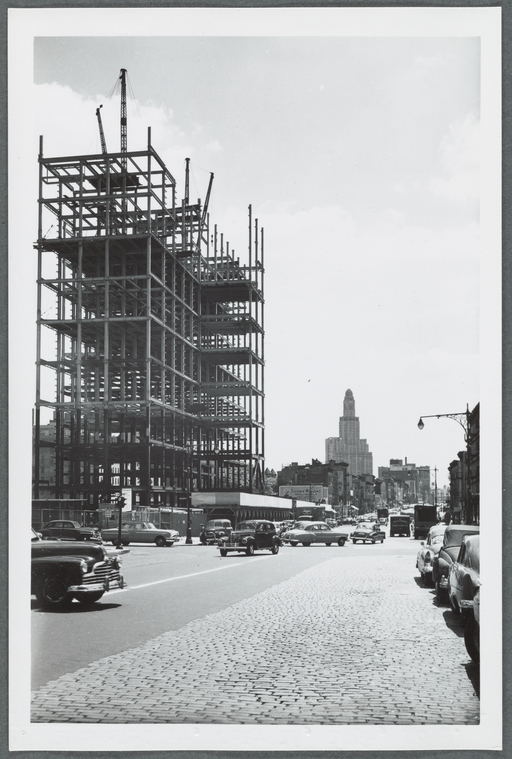 Prison construction on Atlantic Avenue, with cars shown in foreground