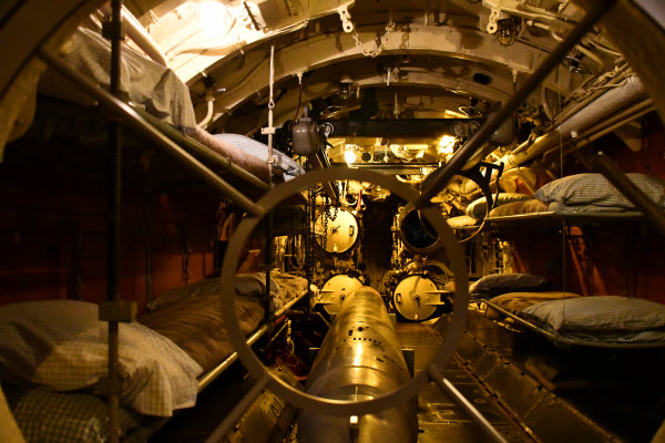 room inside a submarine with a torpedo on the floor