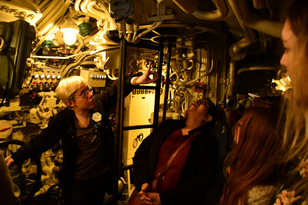 tour guide instructing about the valve of the submarine