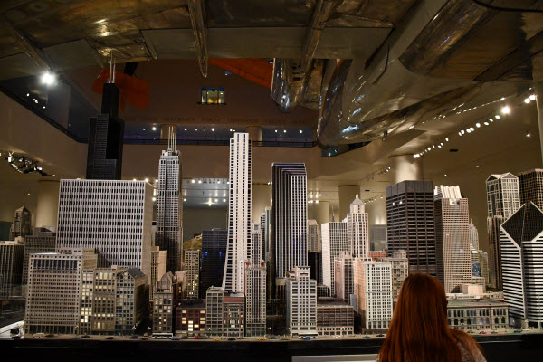 student looking at a model city of Chicago