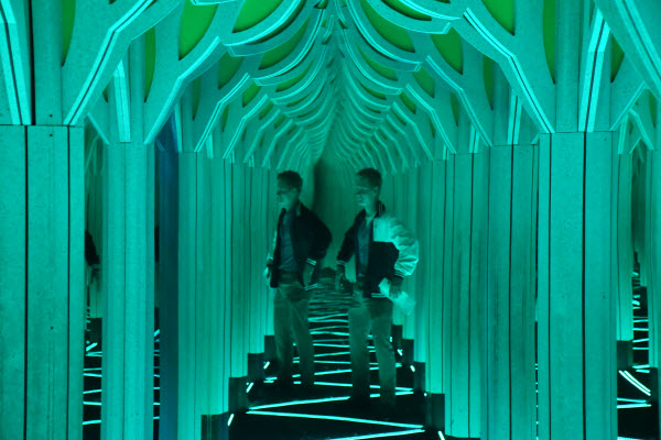 a mirror maze where a student appears twice