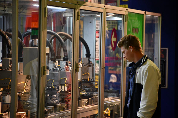 student looking into a toy factory