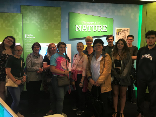 students standing in front of a 'patterns of nature' sign