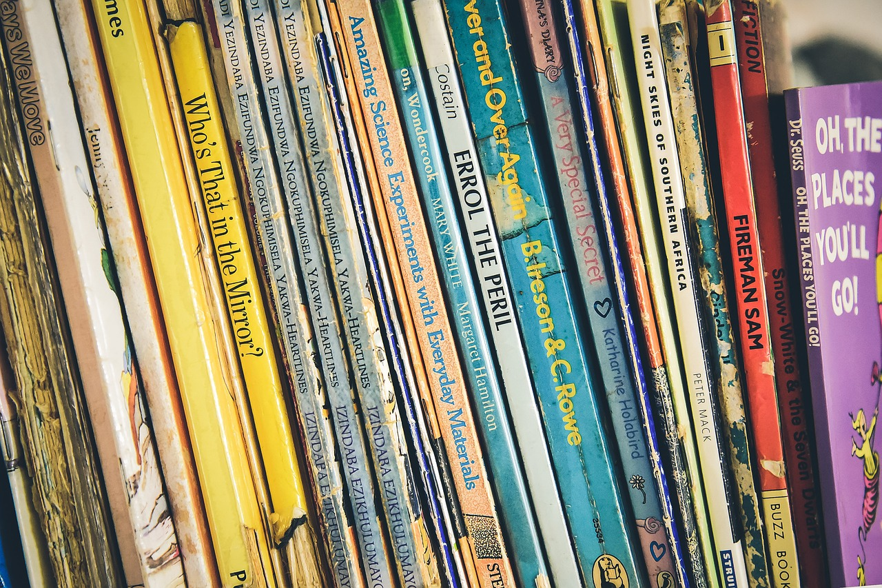 a shelf of children books