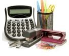 Office Supplies, calculator, stapler, cup with pencils and highlighters
