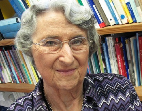 Lilian Katz smiling in front of a book shelf