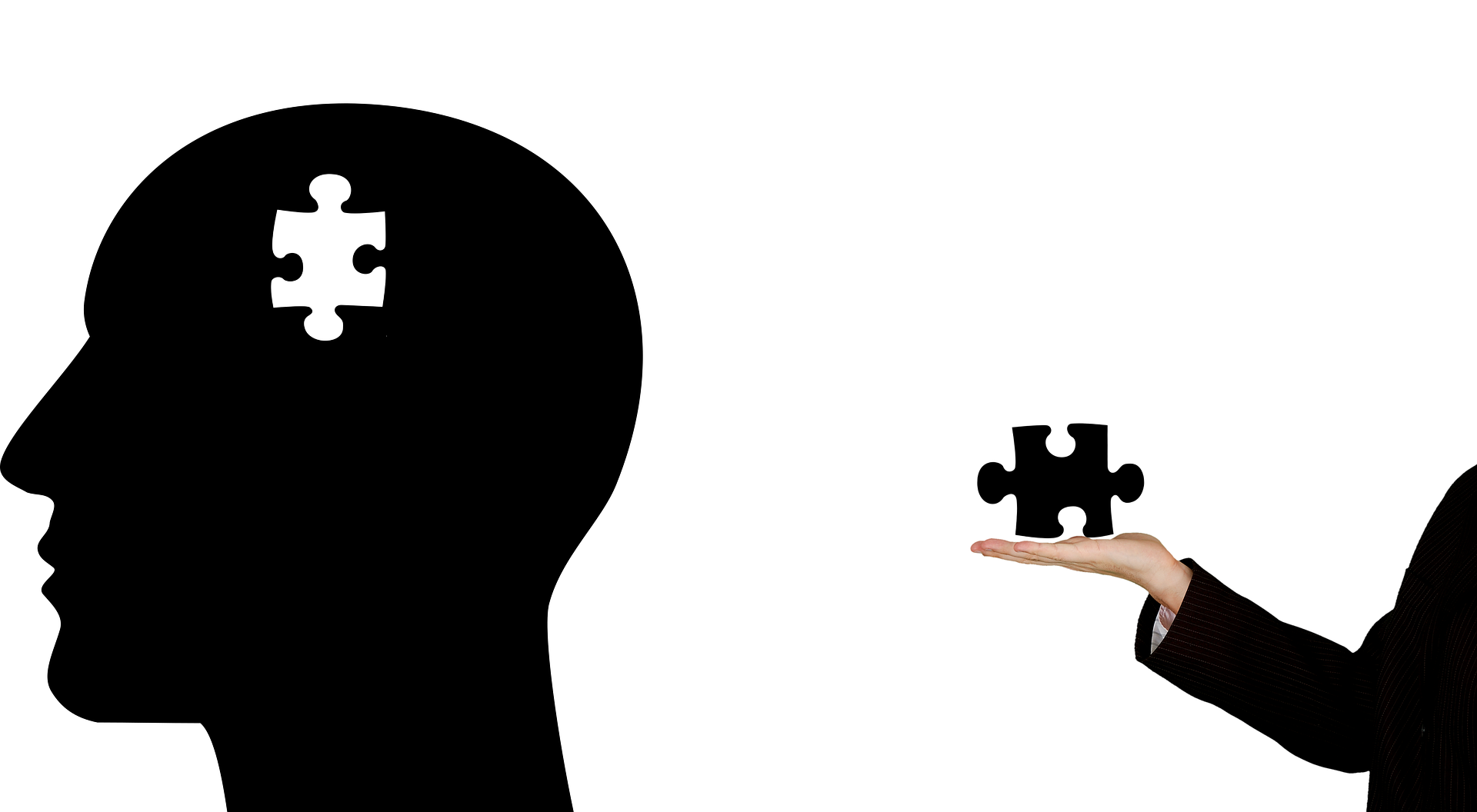 person's silhouette with puzzle piece