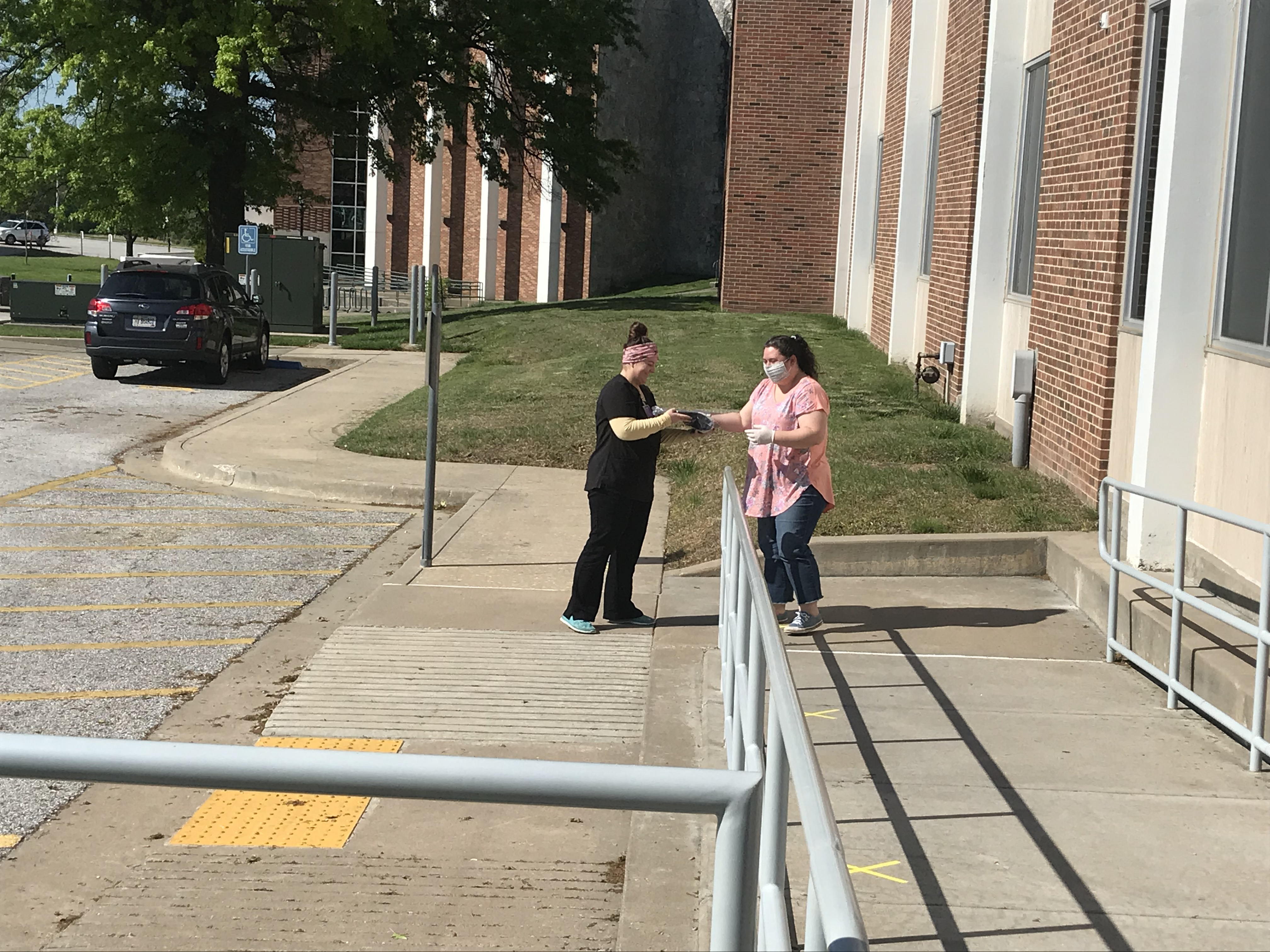 Meghan Henson delivering to a student