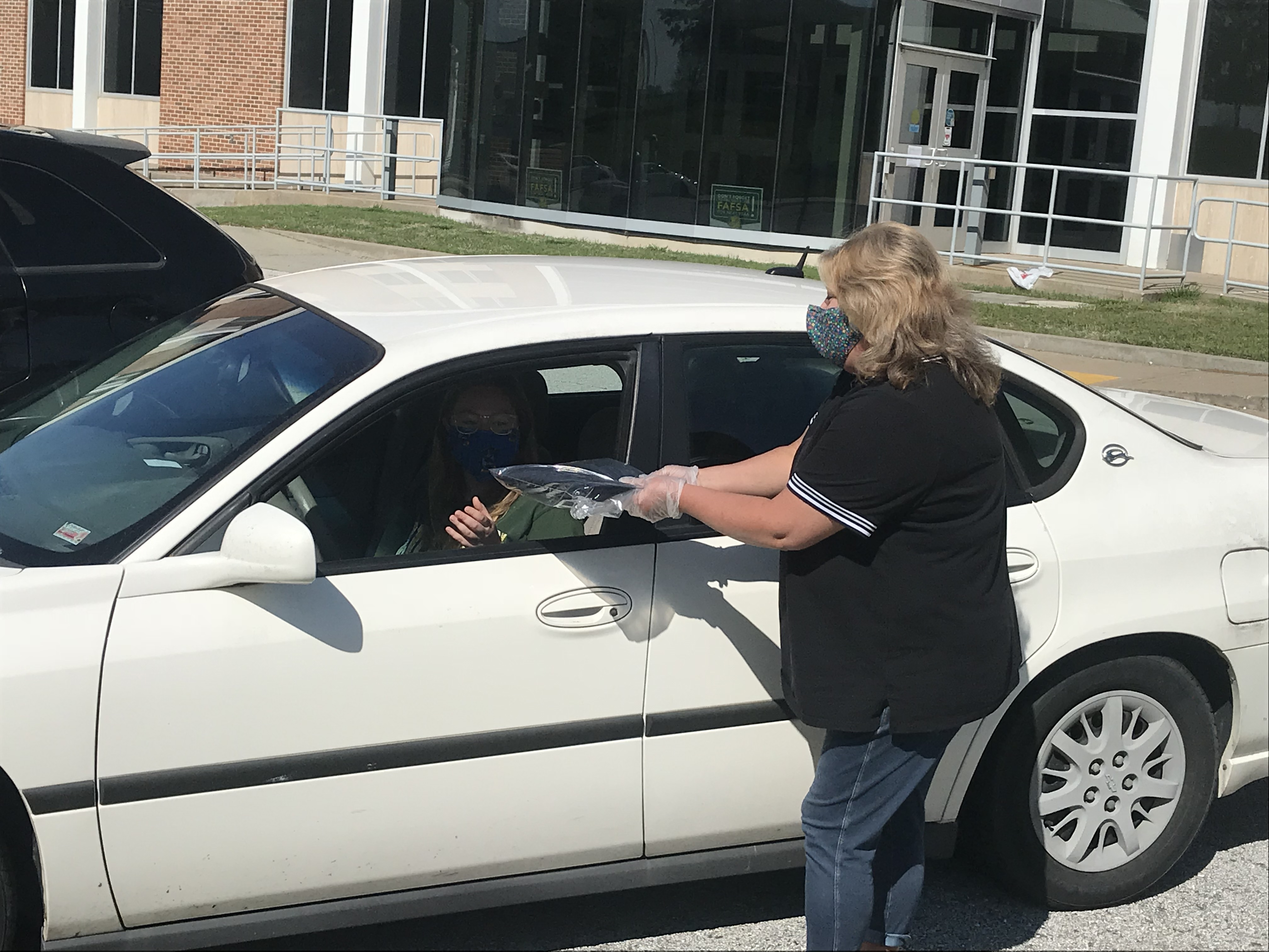 Tina Tracy delivering a pick up order
