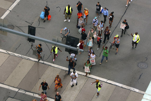 Demonstrators protesting the fatal police shooting of Antwon Rose Jr. walk down the Boulevard of the Allies in downtown Pittsburgh
