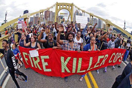 Demonstrators protesting on a bridge in Pittsburgh, Pennsylvania where the fatal police shooting of Antwon Rose Jr. took place.