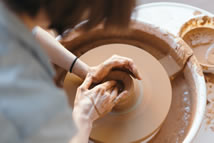 Hands at work on a potter's wheel