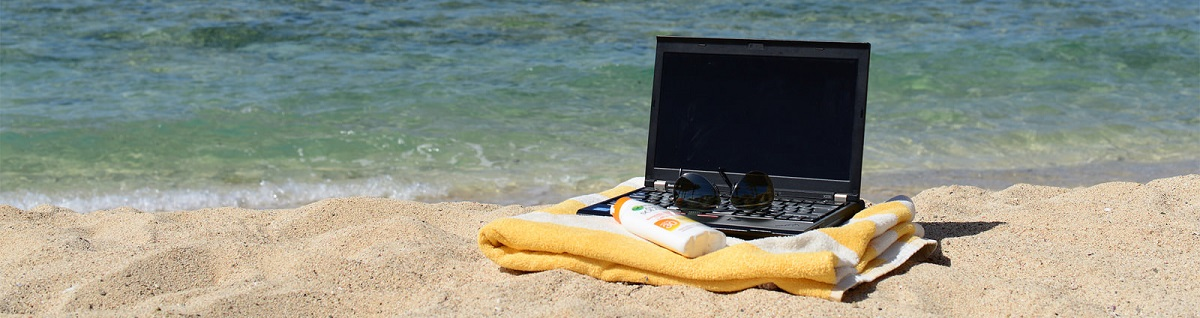 Laptop on the beach by Laura Hoffmann.