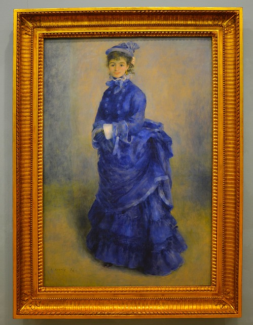 Framed oil painting of woman in blue dress