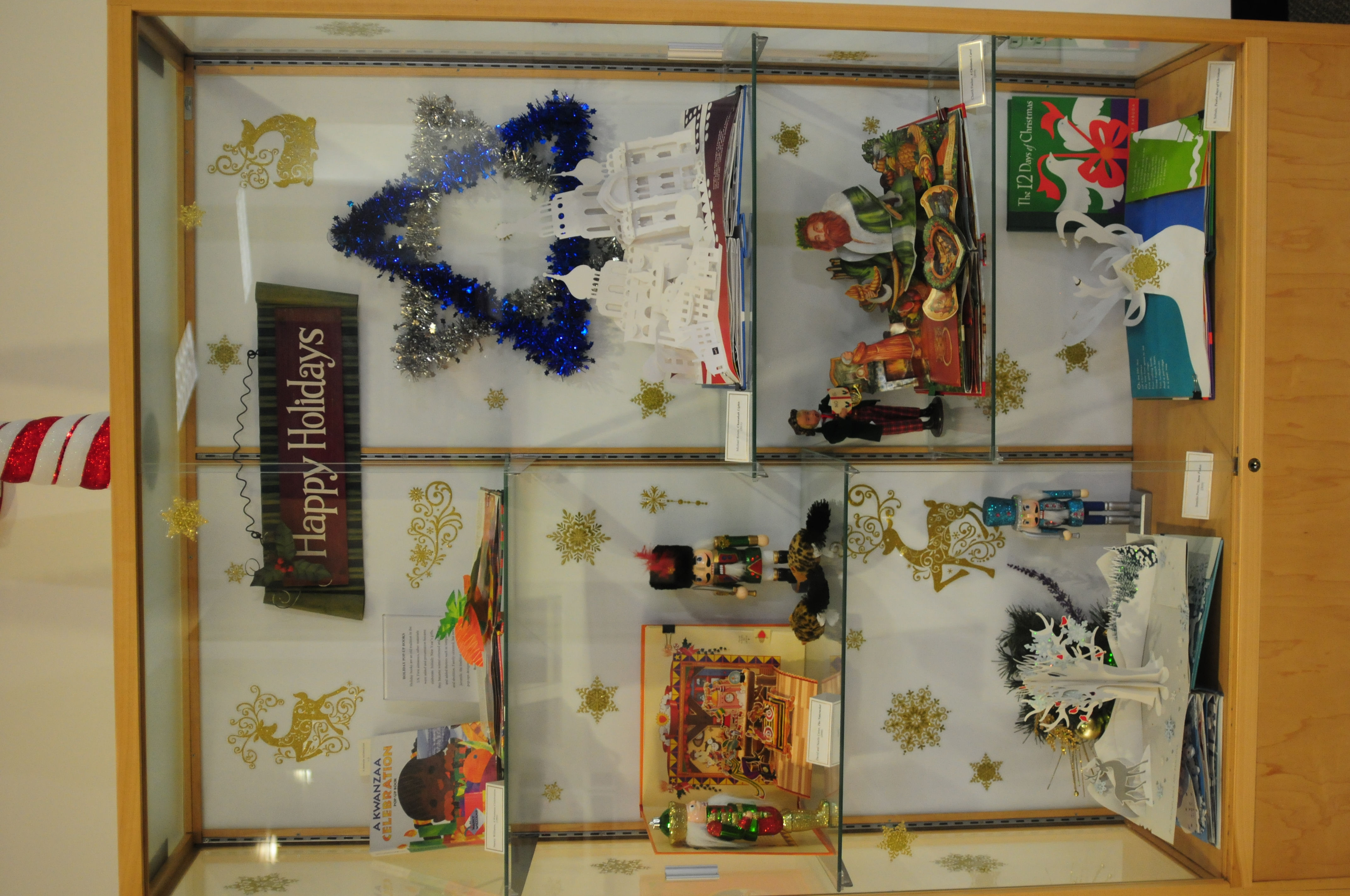 Photo of exhibit case with winter holiday themed popup books