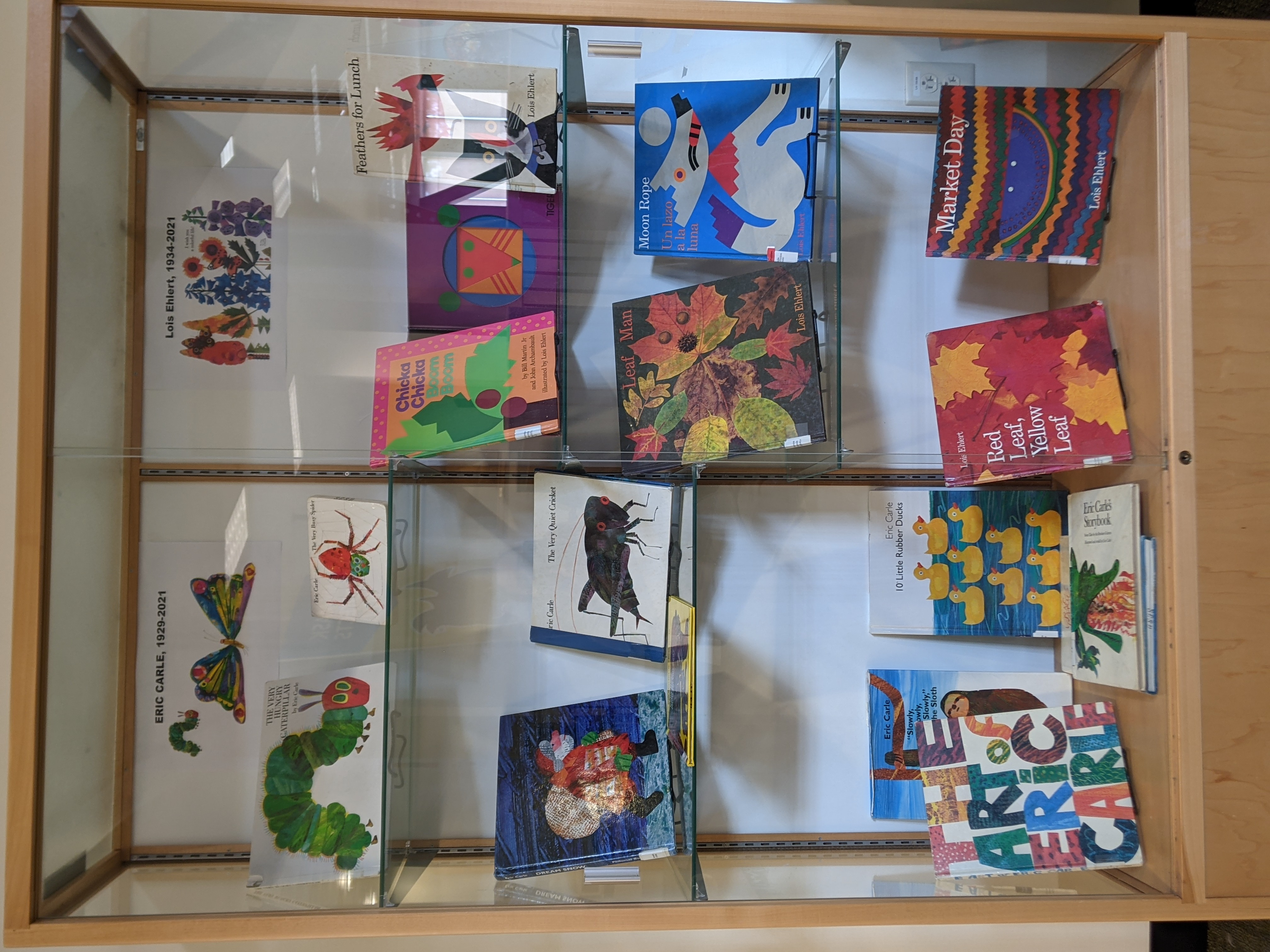Exhibit case with books by Eric Carle and Lois Ehlert