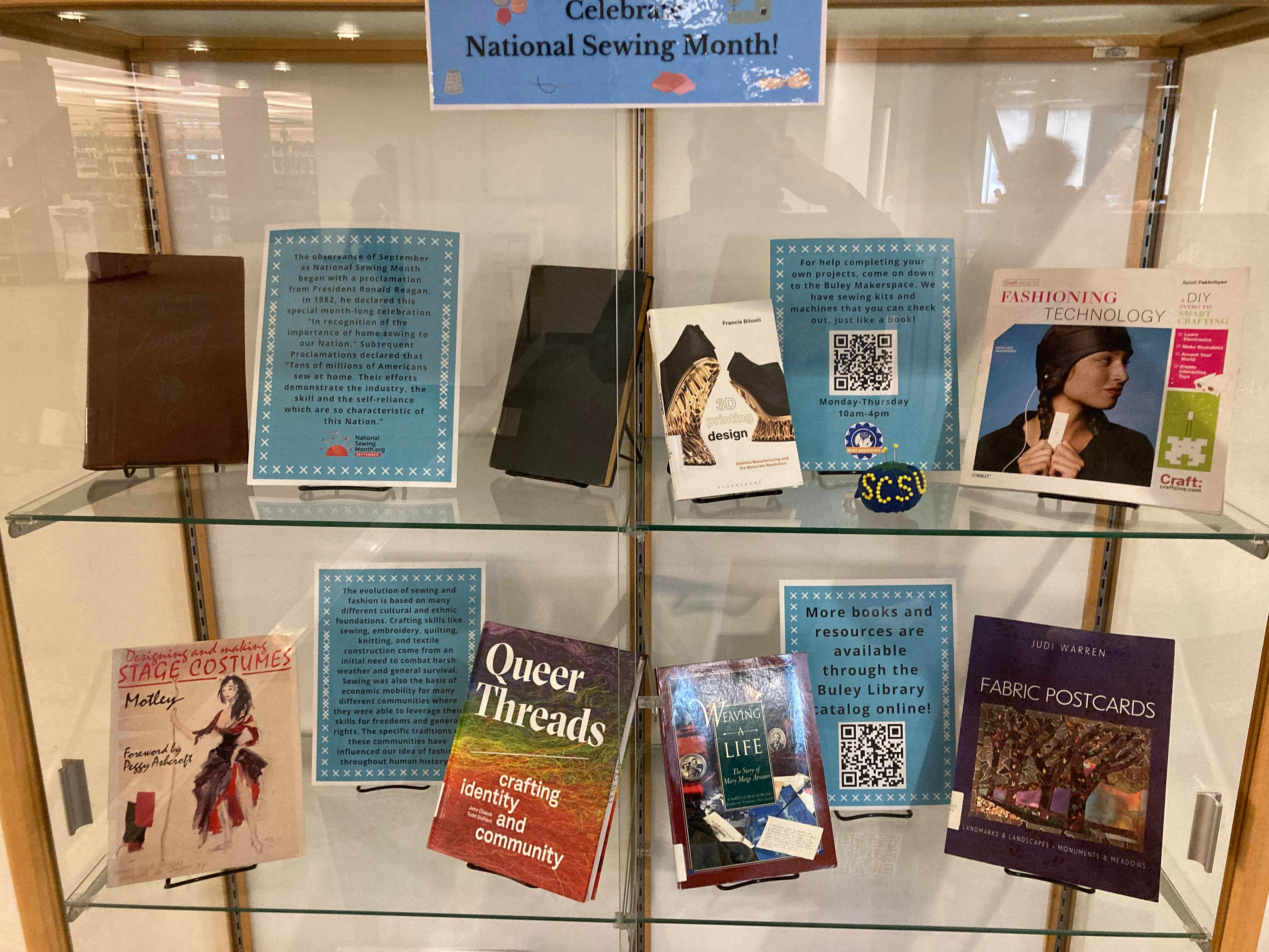 Close up of exhibit case with books on sewing and fashion