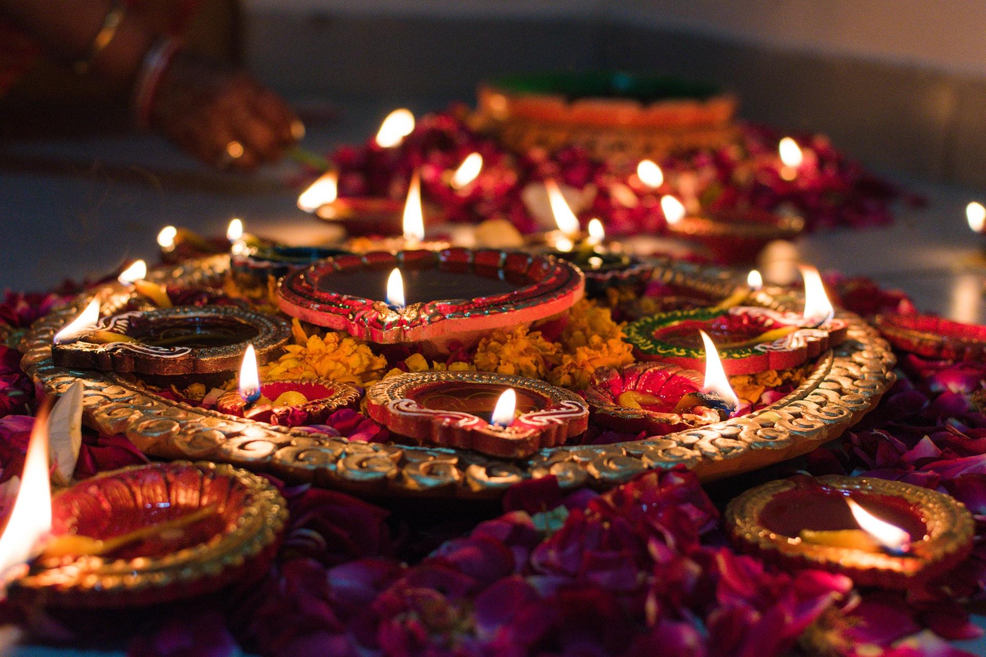 Image of food and lights celebrating Diwali.