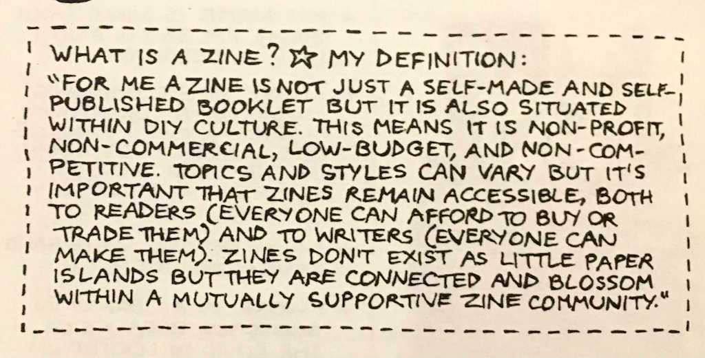 An image of handwritten text defining what a zine is