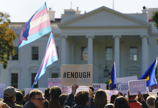 The National Center for Transgender Equality, NCTE, and the Human Rights Campaign gather on Pennsylvania Avenue in front of the White House in Washington, Monday, Oct. 22, 2018, for a #WontBeErased rally
