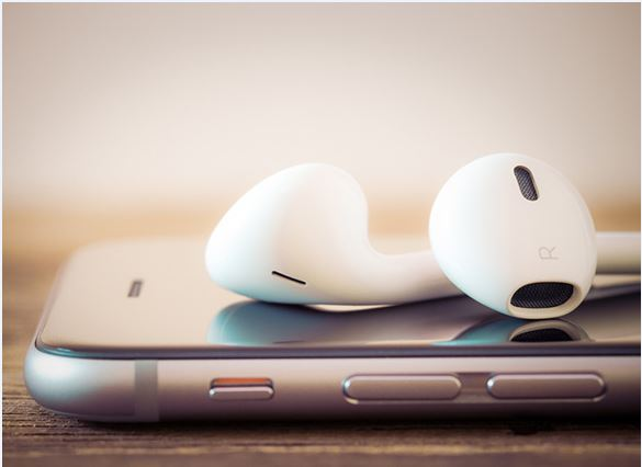 Earbuds on top of device