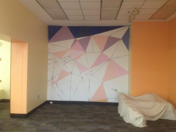white wall with outline of geometric shapes