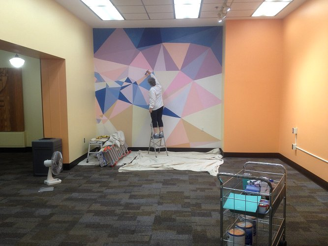 geometric shapes being painted on wall