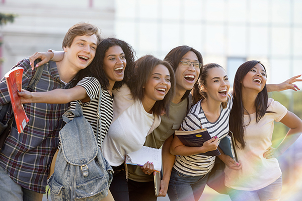 group of diverse college students laughing