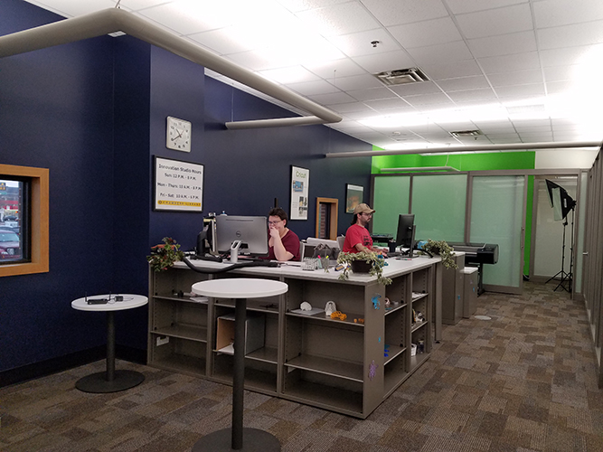 desk and green wall in distance