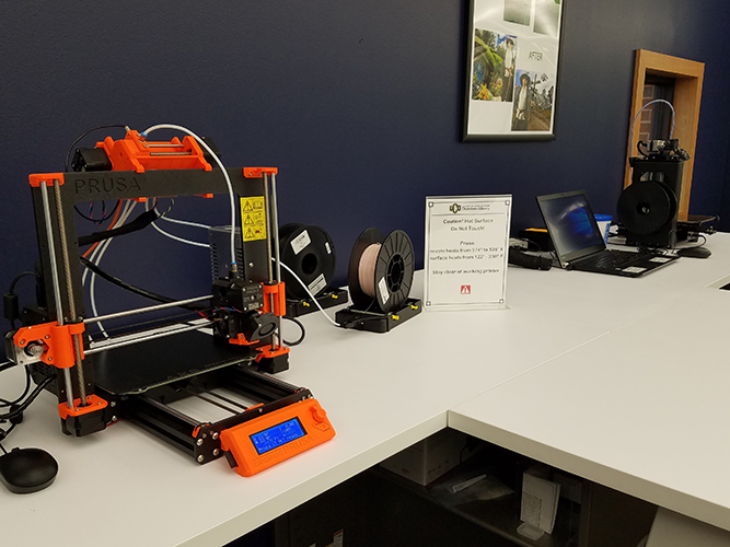 3D printer on white table