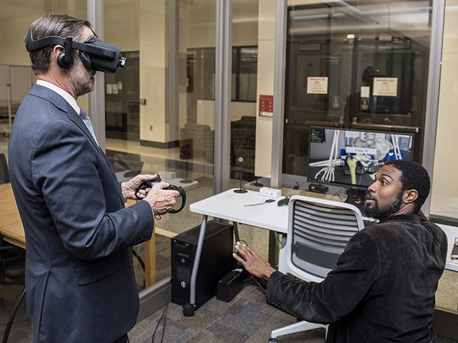 man in suite wearing virtual reality headset
