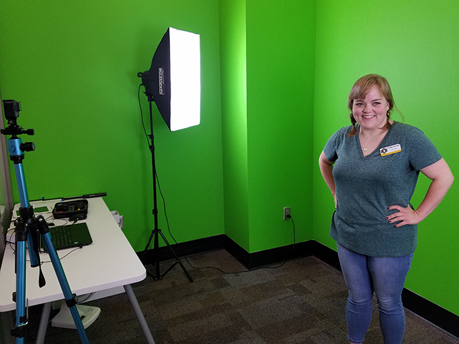 woman in front of green screen wall