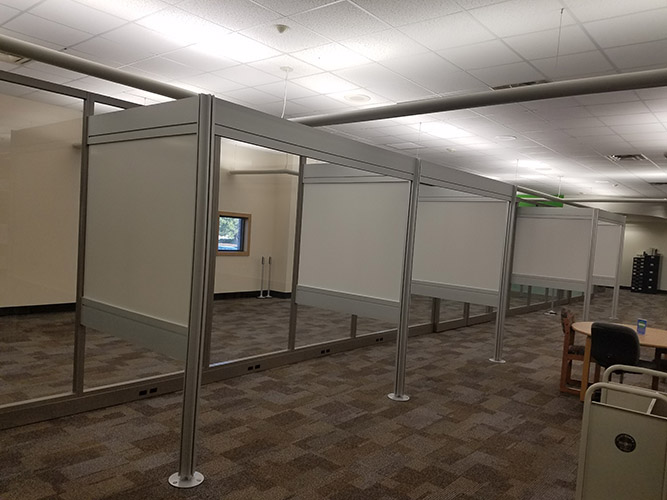 frame of cubicles and glass wall