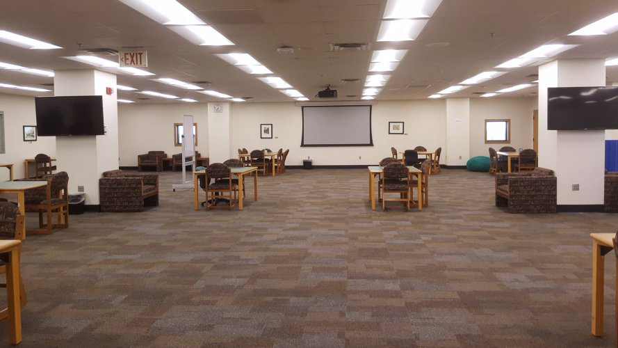 large room with tables and chairs