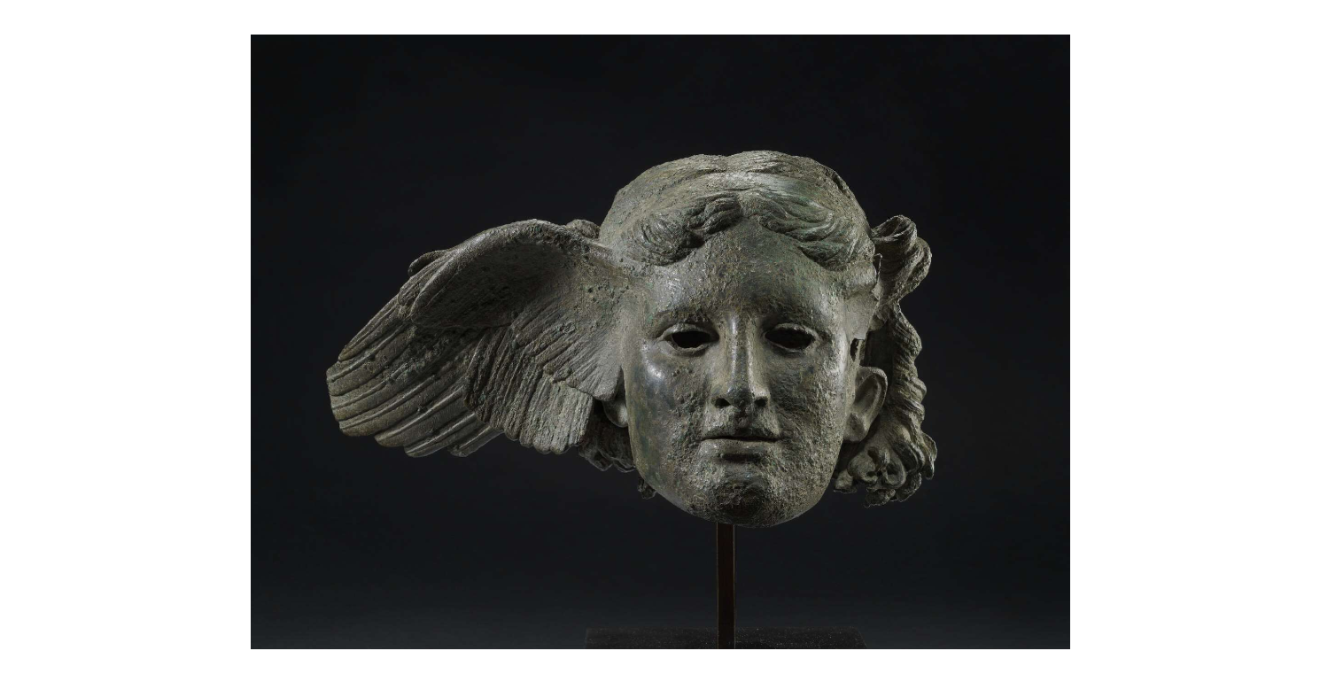 Bronze head from a statue of Hypnos. Wings are shown sprouting from his temples, and his hair is arranged into a series of locks, some falling freely, others tied in a knot at the back of the head.