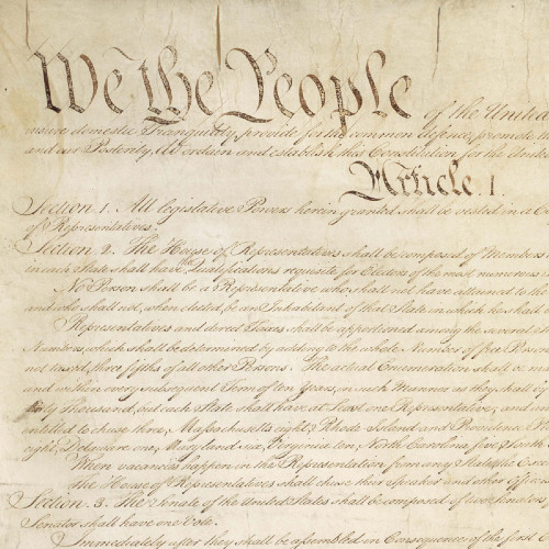 """Image of opening text of the United States Constitution. """"We the People"""" written in large letters."""