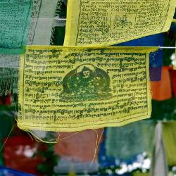 Photo of Buddhist prayer flags at Lumbini by Bo Jayatilaka