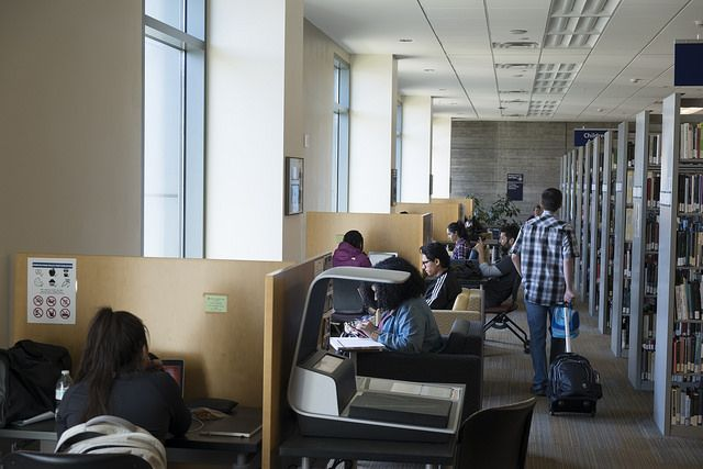 Photos of students studying on first floor of Tioga Library Building